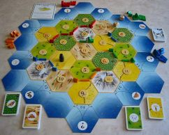 A Game of Settlers of Catan set up and ready to play
